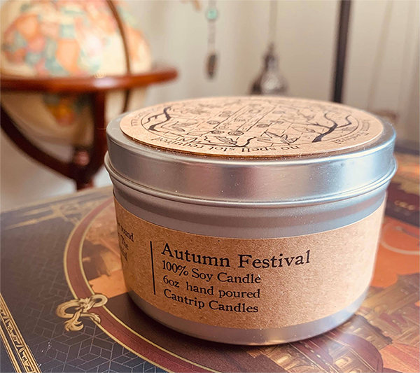 An image of an Autumn Festival candle with a world globe in the background.